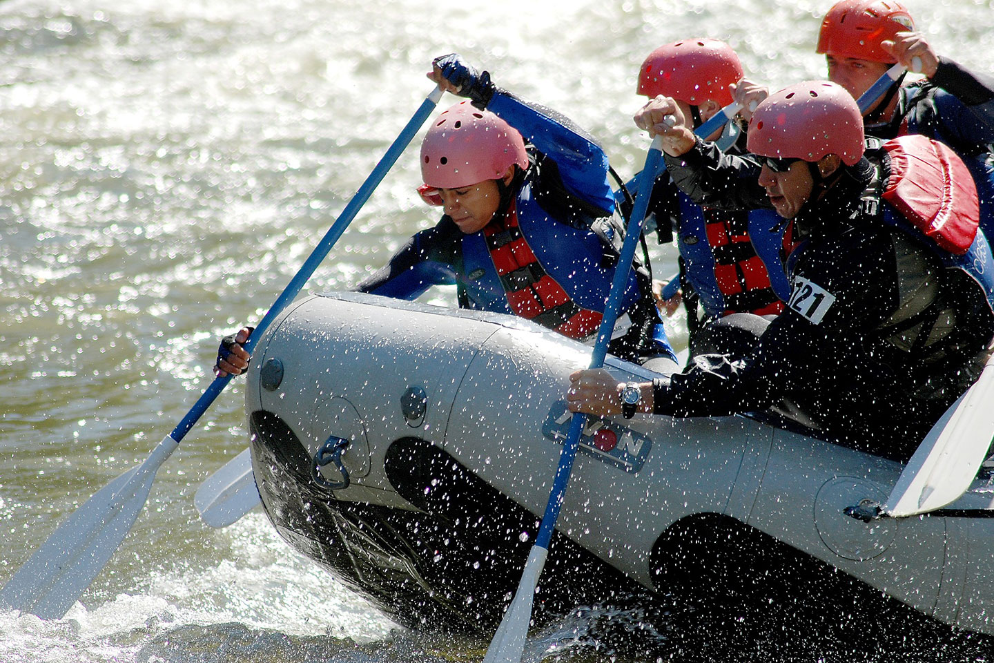 rafting team in a boat